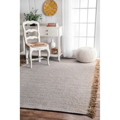 <p>Infuse breezy beauty into any ensemble in an instant with this eye-catching area rug.</p><p>Made in India, it is woven of 100% cotton with a flat pile for a casual look. While playful tassel trim accents either end of its rectangular silhouette, a distressed diamond stripe motif in hues of light gray and true white really steals the show. While it may be bold, its muted palette makes it work in more subtle spaces.</p><p>Let it lay down between a pair...