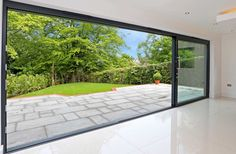 Aluminium sliding doors opening onto patio.
