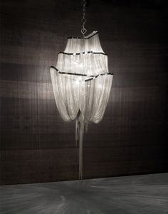 Atlantis by Terzani. Hundreds of illuminated lengths of draped nickel chain – measuring three miles in total – cascade down from the gloss nickel band giving the impression of tentacles hanging down into the abyss of the ocean.
