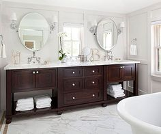 This double vanity with the dark wood base and light marble countertop has a rich, luxurious feel:  http://www.bhg.com/bathroom/vanities/bathroom-vanity-picks/?socsrc=bhgpin092614customcreation&page=7