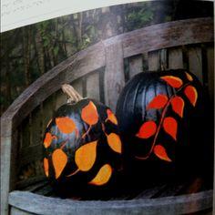 Black Magic... Paint pumpkin black. Take out innards. Carve leaf prints onto pumpkin.