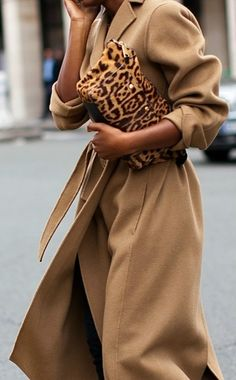 camel coat, leopard clutch.