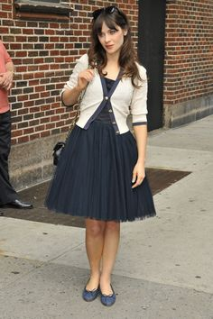 How to wear a tulle skirt with a girly cardigan and ballet flats.
