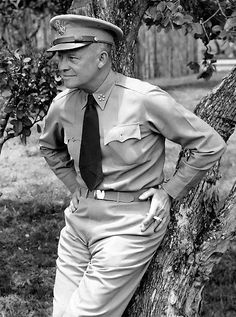 General of the Army Dwight D. Eisenhower, Supreme Commander Allied Expeditionary Force in Europe during World War II. Note the five stars on his collars, his cigarette.