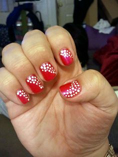 In honor of February!! Red nail polish with white dots :)