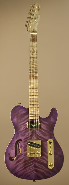 Ruokangas Guitar - Mojo Grande. RESEARCH- a MOST POPULAR RE-PIN in 4 weeks. #DdO:) - INSTRUMENTS FOR JOY -  https://www.pinterest.com/DianaDeeOsborne/instruments-for-joy/ - Hand-crafted electric guitars by Finnish luthier Juha Ruokangas, who alone designs & builds his creations like this gold & lavender quilted hollow body electric. Models incl Duke, VSOP, Mojo, Hellcat & Unicorn. Company builds guitars using traditional methods – no modern computer controlled machinery. Photo pinned via…