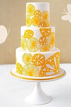Simple and refreshing, three tier white and yellow wedding cake. Decorated with hand painted lemon and citrus shapes all over the cake. By LovinSullivanCakes - From www.cakepower.com
