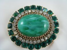 This i large and showy approximately 2 1/4 inches across one replaced check my website at http://vintagecollector.ca/