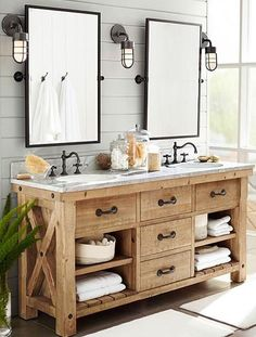 Wooden vanity, accent wall, industrial lighting, two mirrors/sinks