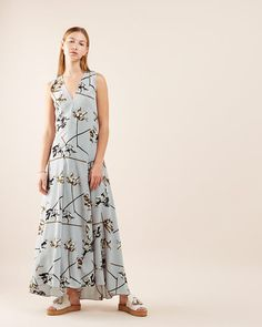 Made from silk crêpe de chine with a wash for a soft finish and a beautiful drape, this maxi dress has a slim fit and a modern silhouette. The waist seam and bust darts fit the dress elegantly to the bodice, while the bias cut accentuates the fluid drape of the skirt. Part of our Marcus James collection, it tells a story of balance and beauty. The illustrative British artist was inspired by order (the concept behind our Spring/Summer collection is order and chaos), to create a set of flo...