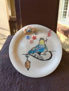 Beautiful bird on a street lamp ceramic plate