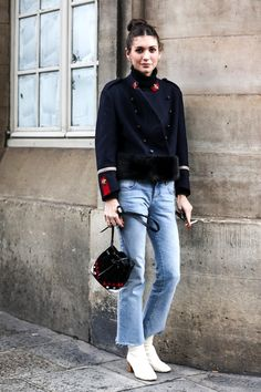 Le Fashion Blog Winter Street Style Diletta Bonaiuti Pfw Bun Navy Coat Black Leather Bag Cropped Raw Hem Jeans White Heeled Ankle Boots Via Sandra Semburg photo Le-Fashion-Blog-Winter-Street-Style-Pfw-Bun-Navy-Coat-Black-Leather-Bag-Cropped-Raw-Hem-Jeans-White-Heeled-Ankle-Boots-Via-Sandra-Semburg_1.jpg