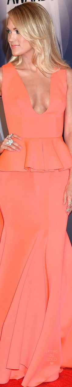 Carrie Underwood wearing a Coral Peplum Dress at the 2016 CMA awards by Indian label Gauri & Nainika.