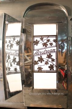 Airstream custom screen door, maybe with mod flowers instead of leaves for our Airstream Travel Trailers, Airstream Living, Airstream Remodel, Airstream Renovation, Airstream Interior, Vintage Airstream, Vintage Caravans, Vintage Travel Trailers, Vintage Campers