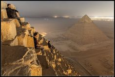A group of Russian photographers climbed the Great Pyramid hiding from guards for four hours after closing time before beginning the ascent