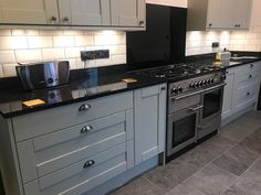High Quality Granite worktops and Quartz worktops manufacturers and installers direct to trade and public with 25 years experience and the lowest prices Kitchen Cupboard Colours, Blue Gray Kitchen Cabinets, Grey Kitchen Tiles, Black Granite Kitchen, Grey Kitchen Designs, Black Granite Countertops, Kitchen Worktop, Kitchen Tops, Home Decor Kitchen