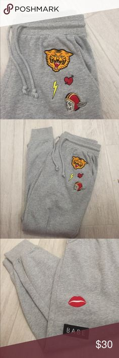 sweatpants insanely soft and comfy sweatpants with cute patches on them. waist tie is adjustable to make smaller or larger. these pants are insanely comfy and trendy, never worn Brandy Melville Pants