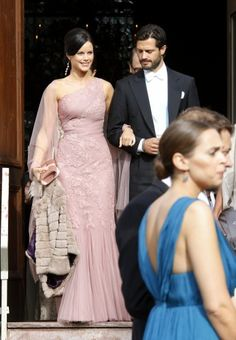 Wow...simply stunning. Sofia Hellqvist displayed this pink gown from the exclusive Swedish store Milagro de Nahrin in August last year at the wedding of former model Vicky Andren and cousin of Prince Carl Philip, Gustaf Magnuson. She matched the gown with a fur jacket from Swedish brand By Malina. Crown Princess Victoria owns a similar one.
