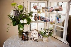 Gift table with a windowpane photo display on one corner of it, so cute! I will find a windowpane and make this! :D