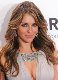 Elizabeth Hurley Hair Color Formula - Base Color – Scalp to Midshaft: 6N (1oz) 7AH (1oz) Silver Concentrate (1/2oz) Mix with: 20 volume developer Mids/Ends Color: 6GD (2oz) 6TO (1/2oz) Mix with: 20 vol developer Baylayage lighter pieces: Blue Lightening Powder with 10 mL of Naturlite Oil Mix with: 20 vol developer