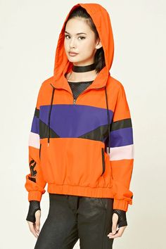"A lightweight woven windbreaker jacket featuring colorblocking on the front and sleeves, a ""Squad"" graphic down one sleeve, a partial zip-up front, drawstring hoodie, front welt pockets, and elasticized trim on the sleeves and waist."