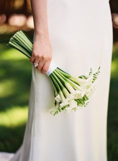 Elegant white orchid bouquet: http://www.stylemepretty.com/2014/05/12/summer-garden-wedding-in-new-york/ | Photography: Judy Pak - http://www.judypak.com/