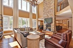 love a 2-story great room and all of the natural light, plus the tv over the fireplace means the furniture is always pointed in the right direction.