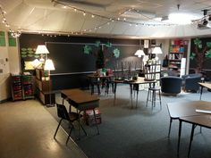 This room has it all.  Lamps and rope lights, open feel, non-patterned furniture arrangement, stations or distinct areas.  I love how inviting this feels.