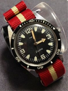 Timex Skin (?) Diver vintage watch. Don't know if the watch was a functional diver, but a great design & strap makes it look even better.