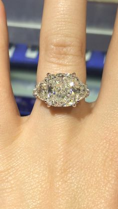 Perfection. 5.3 carat cushion cut with two .7 half moons flush on either side.