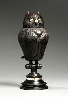 """Owl cup 16th. century - Owl Cups were presented as trophies to the best archers. This Owl Cup was made in Flanders in the 16th. century. To date it is the only known Owl Cup to be made in ebony, which makes it a very rare showpiece indeed. The eyes, beak and the band bearing the inscription are in silver. The inscription reads """"Hvyben Al Sydy Van Plvymen Slecht Nogtans Veel V Begeren Als Gy Staet Recht""""."""