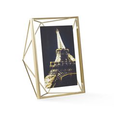 This frame jumps out at you with a structure like an expertly cut gem. Its satiny brass finish makes a modern contrast against ceramic and dark wood.  Find the Gem Photo Frame, as seen in the Christmas in the City  Collection at http://dotandbo.com/collections/styleyourseason-christmas-in-the-city?utm_source=pinterest&utm_medium=organic&db_sku=UMB0105