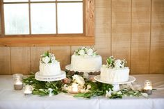 multiple cakes on vintage stands with lots of greenery <3