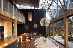 "Kitchen area ""Under Pohutukawa"", Piha, Auckland, New Zealand by Herbst Architects Ltd"