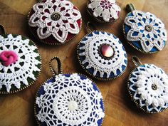 ornaments with crochet, vintage buttons and zipper - personally i see a pincushion :)
