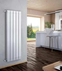 Hot water radiator / wall-mounted / vertical / aluminium GARDA S/90 Fondital