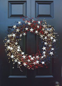 """Americana Wreath for Memorial Day or Fourth of July ~ grapevine base with RW&B berry pips & white metal stars ~ as shown, 22"""" for $85   from ElegantWreath shop @ Etsy"""