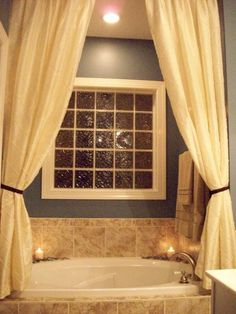 Love the idea of putting curtains over tub!
