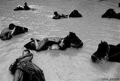 Image by @jack_picone The boys are novice monks from Golden Horse Monastery in the mountains above Chiangrai and on the Thai-Burma border. The heat was relentless and unforgiving they rode their ponies into the river to cool them down and wash them. A few seconds before they were doing back flips of their backs. Then exhausted they just laid there quietly in reverie. One of my dearest friends and one of the finest and most poetic photographers I have the privilege of knowing. Like the others…