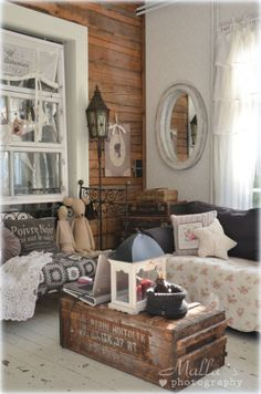 Shabby chic decor , old crate coffee table, iron bed sofa, lots of rustic style . I love this. Anna www.melodymaison.co.uk