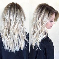 Hair that has it all...lived-in waves, shadow root, bright and beautiful blonde, a healthy shine. Olaplex stylist @beckym_hair nails this look #blonde #platinum #healthyhair #olaplex #hair