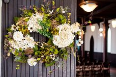 Downton Abbey themed Wedding Ceremony. Photo courtesy of Neil Boyd Photography. Floral wreath found at Hobby Lobby.