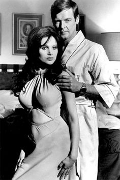 Miss Caruso (Madeline Smith) and James Bond (Roger Moore) with his Pulsar P2 watch