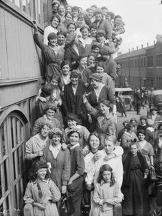 Women Industry during WWI.  Birmingham. 1918   A large group of women workers smile and wave for the camera as they crowd down the steps outside their canteen at an aeroplane factory in Birmingham.