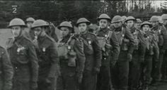 Jozef Gabcík (third from the left), Jan Kubiš (next behind him), Jan Hrubý (third from the right, of small stature). Photo from http://www.ceskatelevize.cz/porady/10350893065-heydrich-konecne-reseni