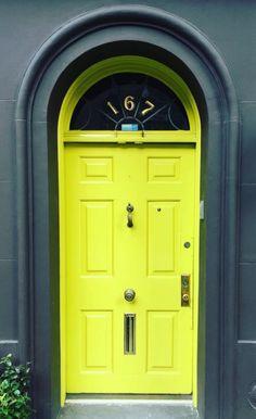 Chartreuse green door in New York City, New York.