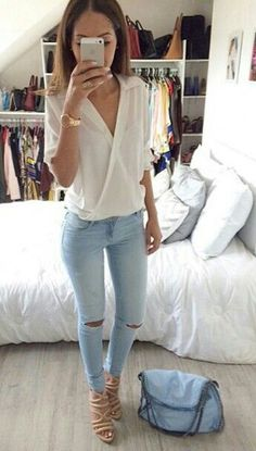 chic street style knee ripped jeans with wrap white blouse