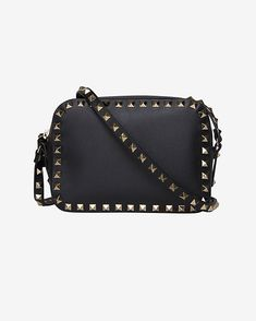 Valentino Rockstud Camera Bag: Black: Rockstuds give this camera bag an undeniable vintage inspired style. Adjustable strap. Top zip closure. One inside open pocket. Lined. Measures: 8 W X 6½ H X 3 D. In black.   Made in ...