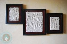 footprint - the finished product  To start you need   a picture frame. It needs to be one that has glass and space between the photo or in this case the mold and the glass. I purchased mine at Walmart it was $8 for 5″ x 7″ and I believe $12 for 8″ x 12″.   a container of plaster of Paris ($5)   a brush   2 strong elastics   some sand (2 cups)   mixing cup and some water