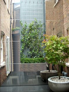 Mirror Finish Stainless Steel Fabrication | Outdoor Design | Cambridge Gate, London